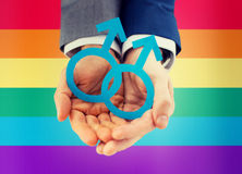 Close up of happy male gay couple with love symbol. People, homosexuality, same-sex marriage and love concept - close up of happy male gay couple holding paper stock photos