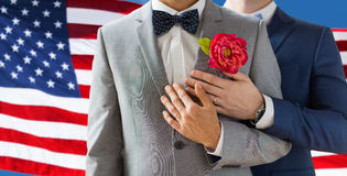 Close up of happy male gay couple. People, homosexuality, same-sex marriage and love concept - close up of happy married male gay couple in suits with Royalty Free Stock Images