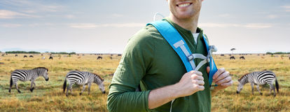 Close up of happy man with backpack traveling Royalty Free Stock Photography