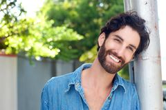 Close up happy man with beard smiling outdoors Royalty Free Stock Photos