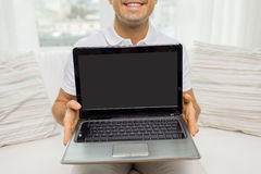 Close up of happy man showing laptop at home Royalty Free Stock Photos