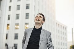 Close up of happy man smiling while going to or from work. stock photos