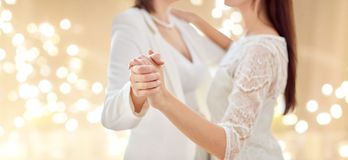 Close up of happy married lesbian couple dancing stock photography