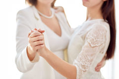 Close up of happy married lesbian couple dancing Stock Images