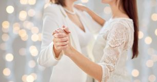 Close up of happy married lesbian couple dancing Royalty Free Stock Photo
