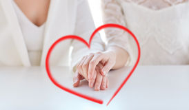 Close up of happy married lesbian couple hands. People, homosexuality, same-sex marriage and love concept - close up of happy married lesbian couple hands Royalty Free Stock Photo
