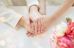 Close up of happy married lesbian couple hands Royalty Free Stock Images