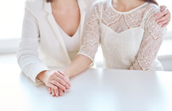 Close up of happy married lesbian couple hugging Stock Photo