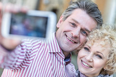 Close-up of happy middle-aged couple taking selfie through smart phone Stock Photo