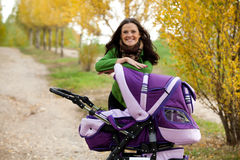 Close-up happy mom with pram Royalty Free Stock Images