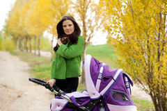 Close-up happy mom with stroller Royalty Free Stock Photos