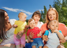 Close-up of happy mothers holding cute babies royalty free stock images
