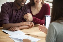 Close up of happy multiracial couple buying home stock image