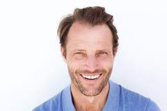Close up happy older man smiling against white background Stock Image