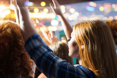 Close up of happy people at concert in night club Royalty Free Stock Image