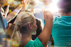 Close up of happy people at concert in night club Royalty Free Stock Photo