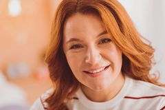Close up of happy red haired woman that watching you. Facial expressions. Attractive female person expressing positivity while smiling on camera stock photos