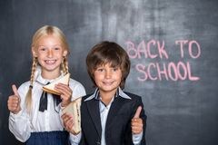 Close-up of happy school boy and girl with Royalty Free Stock Photo