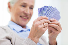 Close up of happy senior woman playing cards Royalty Free Stock Image
