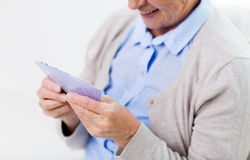 Close up of happy senior woman playing cards Royalty Free Stock Photography