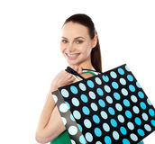 Close-up of happy shopping girl holding bags Stock Photography