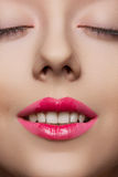 Close-up happy smiling girl face. Joyful smile with white teeth Stock Image