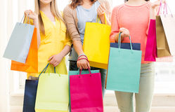 Close up of happy teenage girls with shopping bags Royalty Free Stock Image