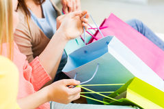 Close up of happy teenage girls with shopping bags Royalty Free Stock Photos