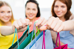 Close up of happy teenage girls with shopping bags Royalty Free Stock Images