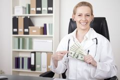 Close up Happy Woman Doctor Holding US Dollars Royalty Free Stock Images