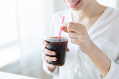 Close up of happy woman drinking coca cola Stock Photography