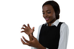 Close up of happy woman gesturing against white background Stock Photo