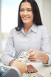 Close up of happy woman giving or exchanging money Stock Photos