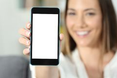 Happy woman hand holding a smart phone screen mockup royalty free stock photos