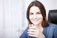 Close up Happy Woman Holding a Glass of Water Stock Image