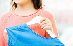 Close up of happy woman holding hanger with shirt Royalty Free Stock Photos