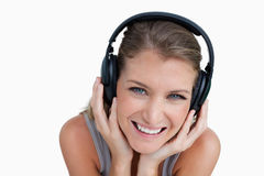 Close up of a happy woman listening to music Royalty Free Stock Images