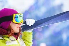 Close-up of happy woman in mask holding ski. Close-up of happy woman in mask standing and holding ski during winter day on Krasnaya polyana ski resort and Royalty Free Stock Photo