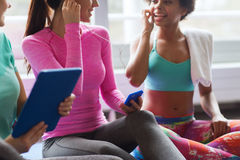 Close up of happy women listening to music in gym Royalty Free Stock Photos