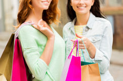 Close up of happy women with shopping bags in city Stock Photos
