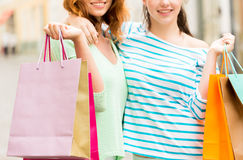 Close up of happy women with shopping bags in city Stock Image