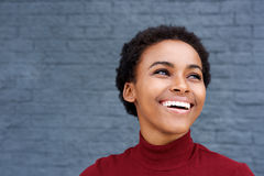 Close up happy young black woman laughing Stock Image