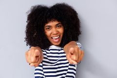 Close up happy young black woman smiling and pointing fingers Stock Images