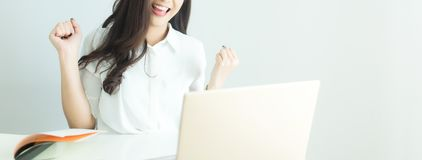 Close up of happy young business woman finished her work with laptop computer in modern office. Banner with copyspace. For your text stock image