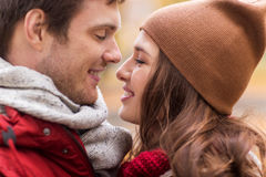 Close up of happy young couple kissing outdoors Stock Photo