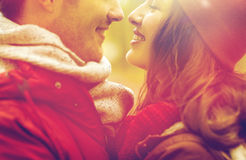 Close up of happy young couple kissing outdoors Royalty Free Stock Images
