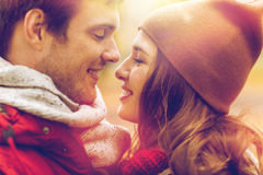 Close up of happy young couple kissing outdoors Stock Image