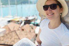 Close up of happy young girl in hat and sunglasses. royalty free stock photos