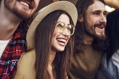 Close up of happy young lady being surrounded by friends stock photos