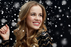 Close up of happy young woman dancing over snow Royalty Free Stock Photo